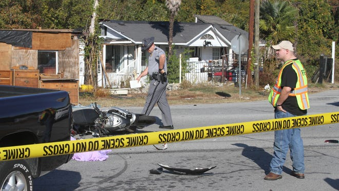 Investigators look at the accident scene from a moped fatality on Nov. 19, 2016