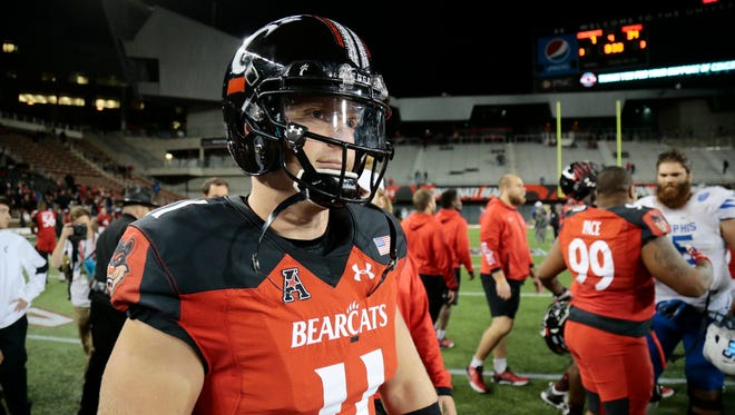Cincinnati Bearcats quarterback Gunner Kiel (11) walks onto the field as time expires in the fourth quarter of the American Athletic Conference college football game between the Cincinnati Bearcats and the Memphis Tigers at UC's Nippert Stadium in Cincinnati on Friday, Nov. 18, 2016. The Bearcats lost 34-7 in the final home game of the season.