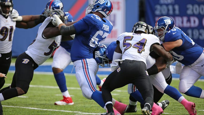 Giants' Justin Pugh (knee) returned to practice Wednesday with the hopes of playing Sunday. (Seth Wenig, AP File Photo)