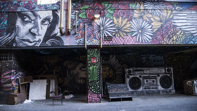 The alley behind Majerle's in downtown Phoenix has murals.  Phoenix is launching a pilot program to clean up its downtown alleys for seating, restaurants, lighting and other activities.