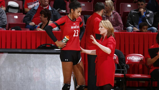 Standout hitter Jordan Thompson (23)  and coach Molly Alvey will lead the University of Cincinnati volleyball team into the NCAA Tournament  this week.