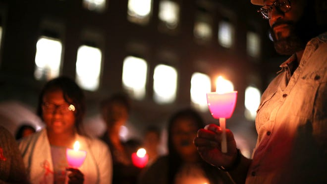 Students share in a moment of silence during Florida State University College of Medicine's 2nd Annual HIV and AIDS Awareness Candlelight Vigil in December. Free testing will be offered Tuesday on National Black HIV/AIDS Awareness Day.