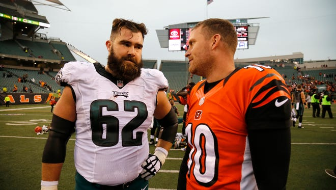 Former UC Bearcats: Philadelphia Eagles center Jason Kelce (62) and Cincinnati Bengals punter Kevin Huber (10) converse at midfield after the fourth quarter of the NFL Week 13 game between the Cincinnati Bengals and the Philadelphia Eagles at Paul Brown Stadium in downtown Cincinnati on Sunday, Dec. 4, 2016. The Bengals defeated the Eagles 32-14 - the team's first win since Oct. 23 against the Browns.