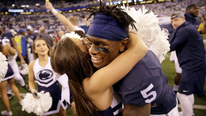 DaeSean Hamilton celebrates not just a Big Ten title but a night of personal redemption for him and his Nittany Lions. This time, the junior receiver helped finish off a remarkable rally.