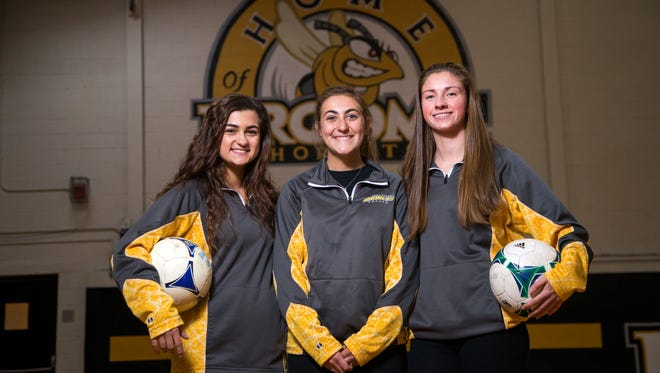 SUNY Broome Community College women's soccer players, from left, sophomore forward Kaelyn Michitti, sophomore midfielder Mikaela Mazerolle, and sophomore defender Emily Gibson.