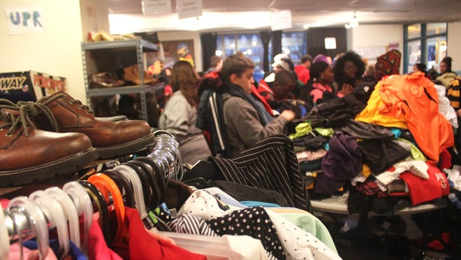 The United Action for Youth winter clothing drive in Iowa City on Dec. 6, 2016, drew a line of people seeking warm clothing.