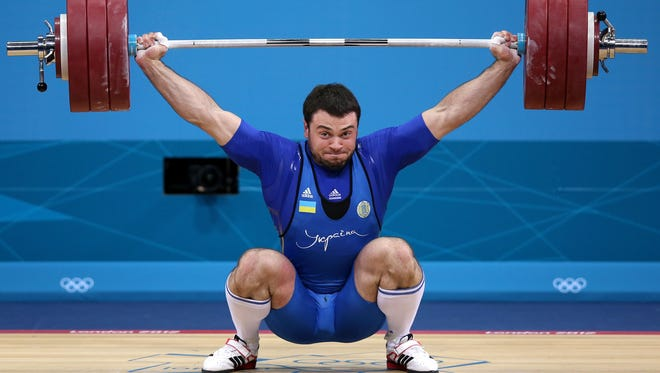 Oleksiy Torokhtiy of Ukraine executes a lift during his gold medal-winning performance in the Men's 105kg Weightlifting at the 2012 London Olympics.