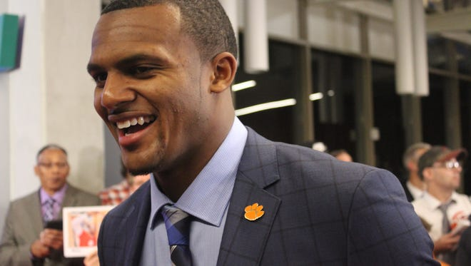 Deshaun Watson talks to reporters on the red carpet before the ESPN College Football Awards in Atlanta.