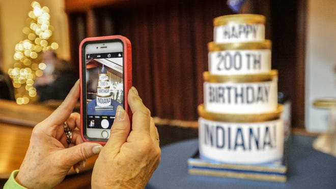 Darlene Sweeney snaps a photo of Indiana's 200th birthday cake during the Indiana Historical Society Bicentennial Bash, Sunday Dec. 11, 2016.