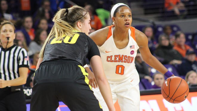 Clemson wing Nelly Perry (0) dribbles the ball while being defended by Oregon guard Sabrina Ionescu (20) in Monday's game at Littlejohn Coliseum.