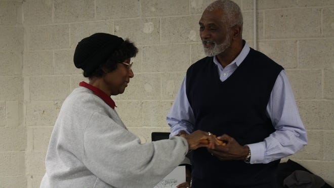 Outgoing NAACP president passes the gavel to new president Geron Tate at the NAACP meeting Monday, Dec. 12, 2016. Tate's goals include increasing membership, increasing youth involvement and starting a dialogue about race in Mansfield.