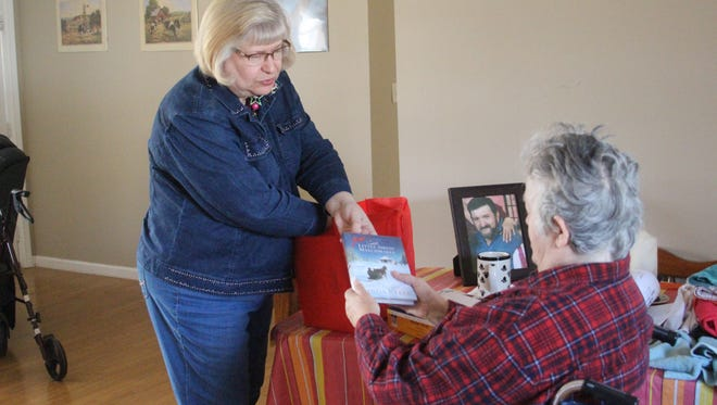 Wanda Sexton, left, delivers books to Linda Beyor on Dec. 8, 2016.