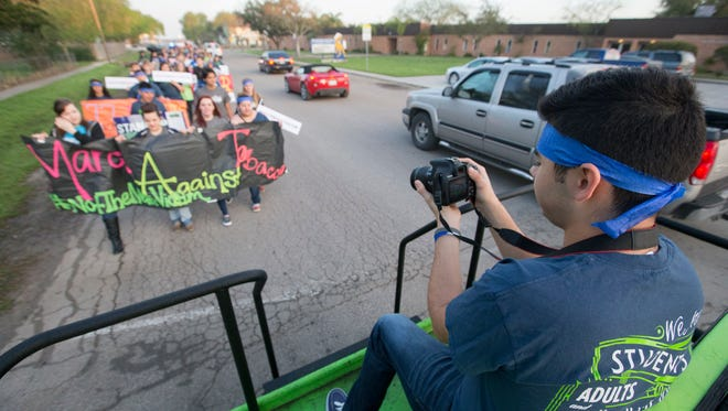 Carlos Vela, a student at Ingleside High School, makes a video during the March Against Tobacco on March 13, 2015.