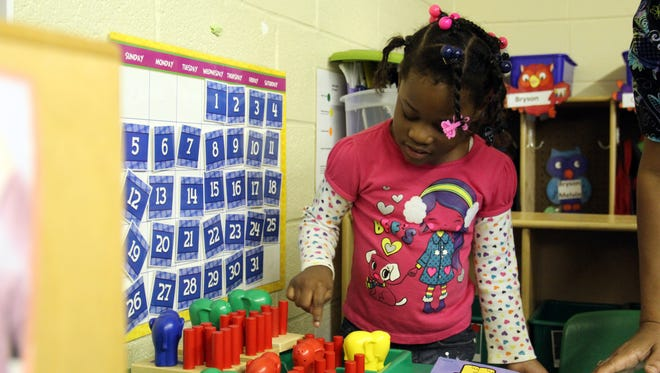 A child plays with toys at a northern Mississippi child care center. Centers will be able to borrow toys and materials from resource centers located at community colleges under the state's new child care system.