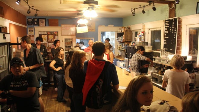 People hang out inside Jobot coffee shop during First Fridays.