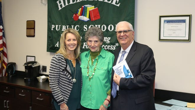 From left: Hillsdale Board of Education President Kathleen O'Flynn; Rosemarie D'Alessandro, president of Joan's Joy; and schools superintendent Jeffrey Feifer.