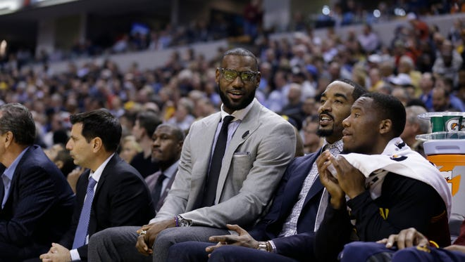 Cleveland Cavaliers' LeBron James and J.R. Smith on the bench during an NBA basketball game against the Indiana Pacers in Indianapolis, Wednesday, Nov. 16, 2016. The Pacers won 103-93.