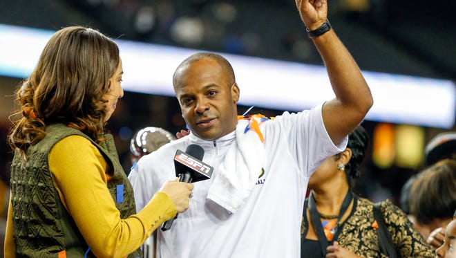 Grambling State coach Broderick Fobbs celebrates a victory against the North Carolina Central Eagles in the Celebration Bowl at the Georgia Dome. Grambling State won 10-9.