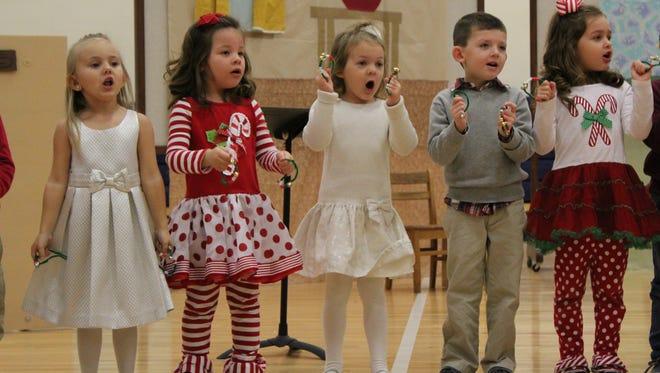 "Students of Mrs. Simmons' PK 4 class, Kaylee Chapman, Savanna Hendrickson, Jerra Johns, Lucas Mills, and Anna Lawyer, recently performed ""Jingle Bells"" during the John Paul II Catholic School Christmas program."