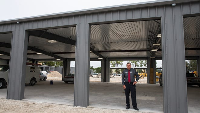 Owner Tim Zellers poses for a portrait in one of the repair bays at the new Tamiami Ford business location in Naples, Florida on Wednesday, Dec. 21, 2016. When construction is complete around February 1, Tamiami Ford will have the brandÕs second fleet and commercial quick lane in the country.