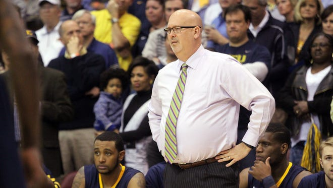 FILE - East Tennessee State head coach Steve Forbes reacts to a play during the first half of the championship game of the NCAA men's Southern Conference basketball tournament in Asheville, N.C., Monday, March 7, 2016. (AP Photo/Ben Earp)