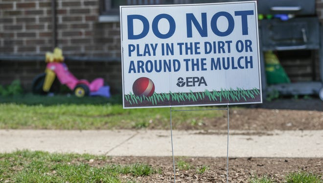 "E.P.A. signs in english and spanish in the West Calumet Complex, in the city of East Chicago warn residents ""Do Not Play In The Dirt or Mulch"", Monday August 22nd, 2016. The public housing complex  was built 1972 on the former site of Anaconda Lead Products facility, which is now a superfund site, and scheduled to be demolished due to lead contamination."