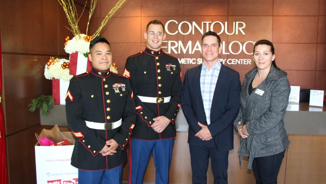 Westley Hegge, Private First Class, and Zac Noren, Corporal, from the Twentynine Palms Marine Corps, Dr. Timothy Jochen of Contour Dermatology & Cosmetic Surgery Center, and Desire Tegge, Event Coordinator with the Coachella Valley Rescue Mission.