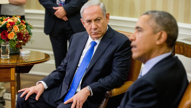 """FILE -- In this Nov. 9, 2015 file photo, President Barack Obama meets with Israeli Prime Minister Benjamin Netanyahu in the Oval Office of the White House in Washington. Doubling down on its public break with the Obama administration, a furious Israeli government said, Tuesday, Dec. 27, 2016, that it has """"ironclad"""" information from Arab sources that Washington actively helped craft last week's U.N. resolution declaring Israeli settlements illegal. The allegations further poison the increasingly toxic atmosphere between Israel and the outgoing Obama administration in the wake of Friday's vote, and raise questions about whether the White House might take further action. (AP Photo/Andrew Harnik, File)"""