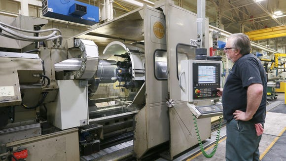 Norbert Tilidetzke operates a CNC shafting lathe in January 2016 at Joy Global in Milwaukee.