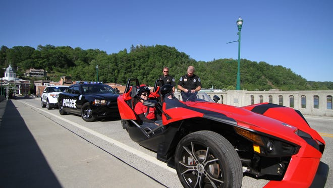 Chief Mike Boone (sunglasses) and Officer John Lunsford of the Marshall Police Department feature in the Governor's Highway Safety Program calendar.