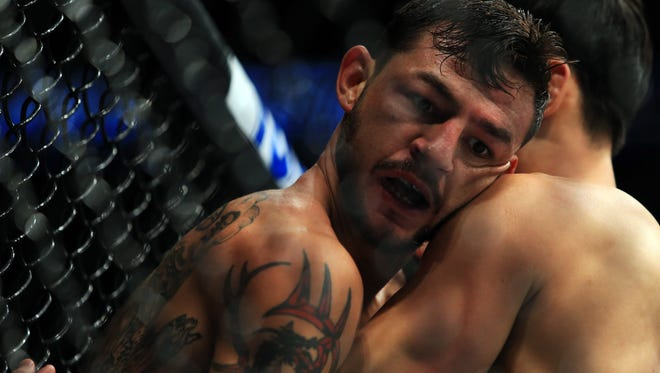 Cub Swanson (L) wrestles with Doo Ho Choi in their Featherweight bout during the UFC 206 event at Air Canada Centre on Dec. 10, 2016.