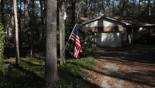 A home along Cherokee Ridge Trail displays an American flag, one of a half-dozen on the block to do so in a four-precinct Trump enclave where Trump garnered between 54 and 58 percent of votes cast.