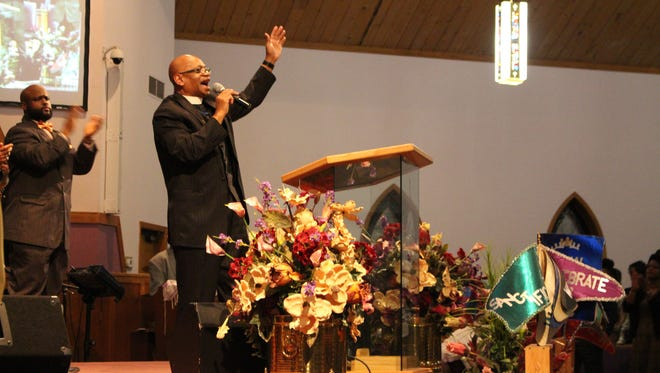 Overseer Clarence Sanderfer preaches to the Oasis of Love congregation about Martin Luther King Jr. during a service Sunday, Jan. 15, 2017. Sanderfer is  pastor at New Life Baptist Church in Mansfield.
