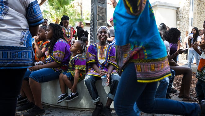 Members of the Macedonia Missionary Baptist Church youth choir laugh and joke around while waiting to perform during the 20th Annual Rev. Dr. Martin Luther King Jr. Parade and Celebration in downtown Naples on Monday, Jan. 16, 2017.