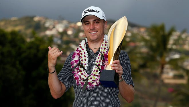 PGA golfer Justin Thomas poses with the trophy after winning the Sony Open golf tournament at Waialae Country Club on Jan. 15.