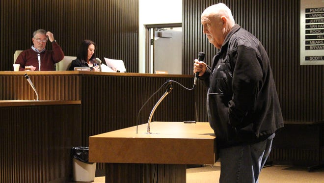 Charles West, owner of C and D Taxi, addresses Mansfield City Council at its meeting Tuesday. West asked council to postpone a vote on a bill to change the city's taxicab laws, and council agreed to table the bill for now.
