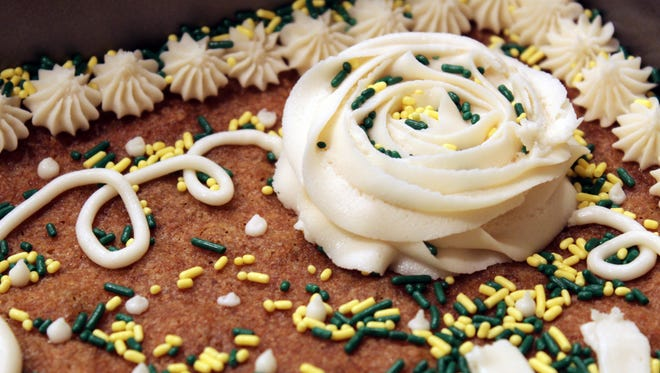 Add as much (or as little) homemade buttercream frosting as you please to your homemade cookie cake.