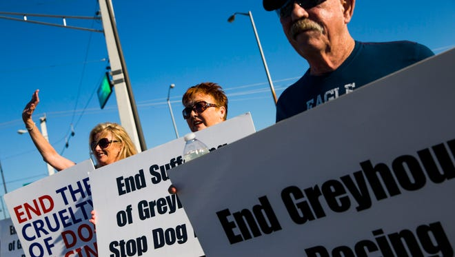 A group of GREY2K USA Worldwide volunteers protest outside of the Naples-Ft. Myers Greyhound Race Track in Bonita Springs on Saturday, Jan. 21.