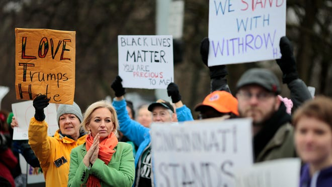 "People show their solidarity with Withrow High School students Monday, Jan. 23, 2017, in Cincinnati. Swastikas, racial slurs and the word ""Trump"" were spray-painted around Withrow's campus this past weekend."