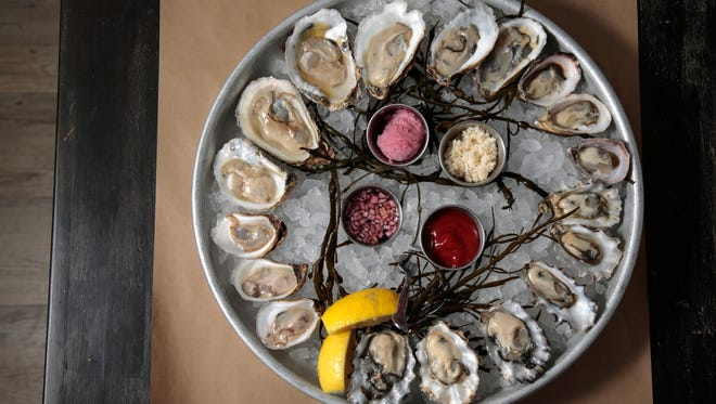 A platter of oysters, featuring Calm Cove, Kusshi, Wildcat Cove, Beausoleil, Riptide and Deleware , pictured, Wednesday, Jan. 18, 2017, at The Anchor seafood restaurant in Over-the-Rhine.