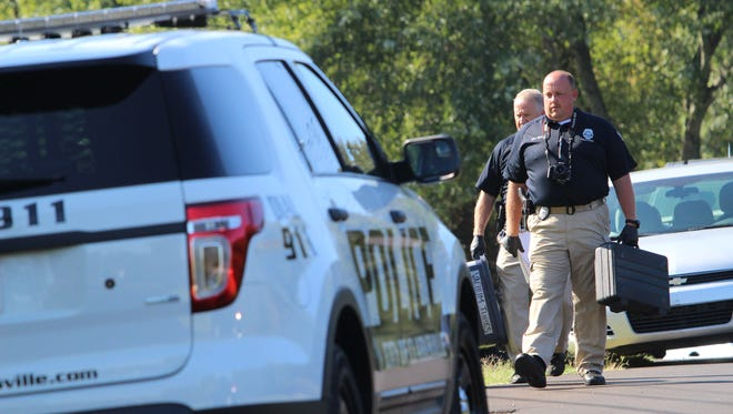 Clarksville Police work to secure a crime scene.