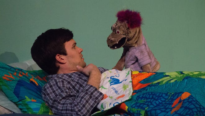 """Jordan Nichols with the foul-mouthed puppet Tyrone in the dark comedy """"Hand to God"""" at Circuit Playhouse."""