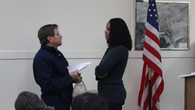 Tiffany Sanders (right), the town attorney for Lecompte speaks with a resident on Thursday evening after a special meeting of the Lecompte Town Council.