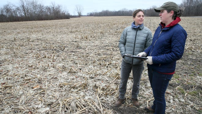 Debbie Maurer (left) of Lake County Forest Preserves and Stephanie Judge of The Nature Conservancy look over a 58-acre property The Nature Conservancy purchased in Kenosha County, just west of the Chiwaukee Prairie natural area.