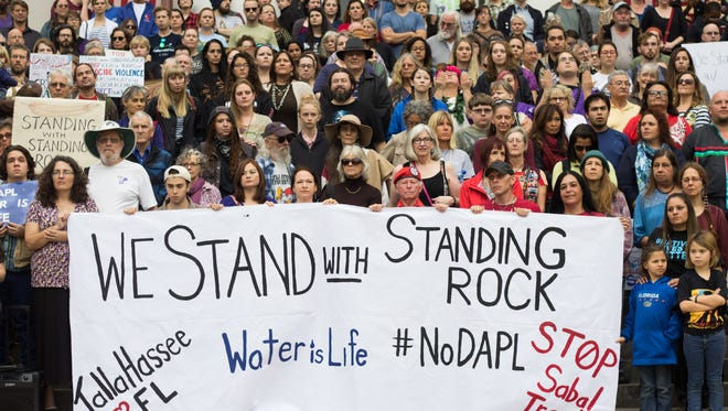 Codi Cain/FSView Tallahassee Stood with Standing Rock, peacefully protesting the Dakota Access Pipeline with native drumming and singing, letter writing to representatives, and fifteen minutes of silence, at the Historic Capitol of Florida in Tallahassee on Dec. 4, 2016. Tallahassee Stood with Standing Rock, peacefully protesting the Dakota Access Pipeline with native drumming and singing, letter writing to representatives, and fifteen minutes of silence, at the Historic Capitol of Florida in Tallahassee on Dec. 4, 2016.