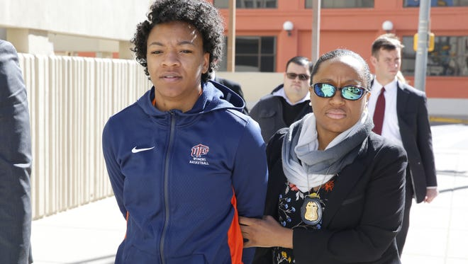 Former University of Texas at El Paso basketball player Jenzel Nash, who was indicted with six other people in connection with a $237,000 bank fraud scheme, is walked into the El Paso County Jail on Monday afternoon after she was taken into custody by federal agents.