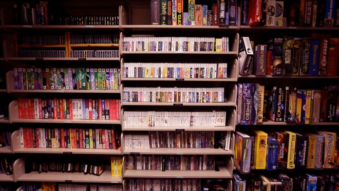 Video games are shelved at the Computer and Video Game Archive at the Duderstadt Center at the University of Michigan. Students and members of the public alike are permitted to visit and play any game available, whether for research or just to relax.
