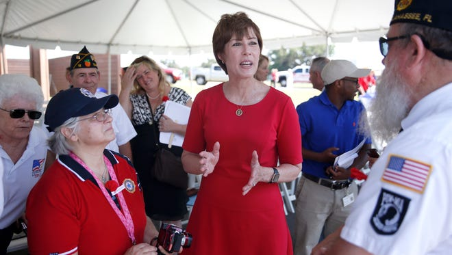 Rep. Gwen Graham speaks with attendees of the Tallahassee National Cemetery Memorial Day ceremony on Sunday.