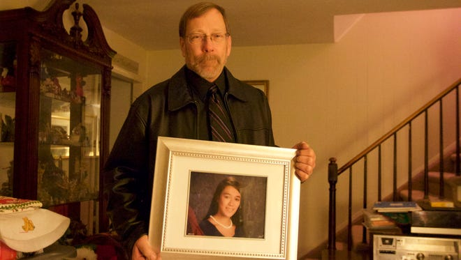 Michael Stern holds photo of his daughter Sarah.  Authorities have charged two of her friends in connection to her death.