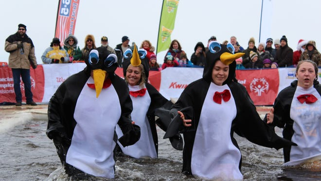 Special Olympics Wisconsin hosted a Polar Plunge on Saturday near Wisconsin Rapids. The event attracted a crowd of hundreds of people to the banks of the Wisconsin River as participants jumped into the frigid water.